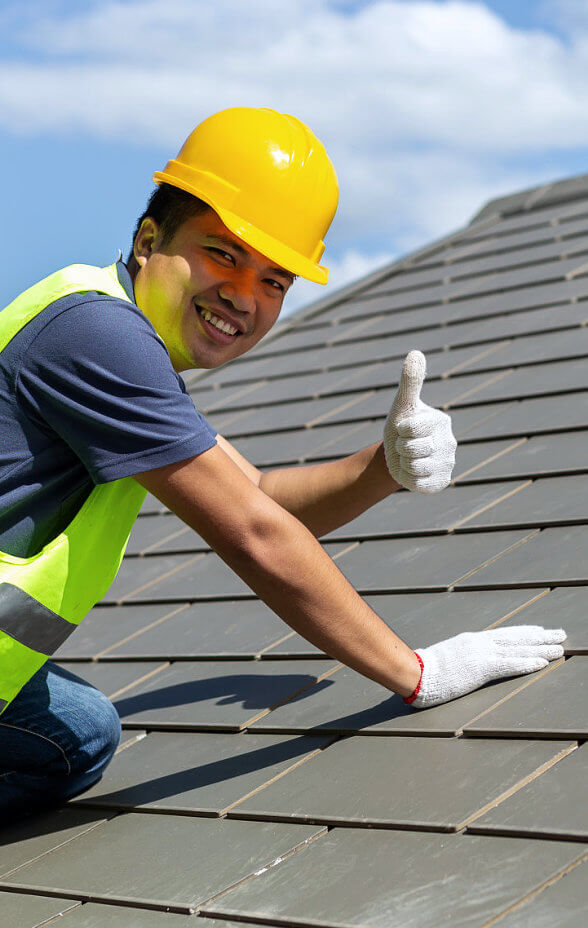 man at roof smiling